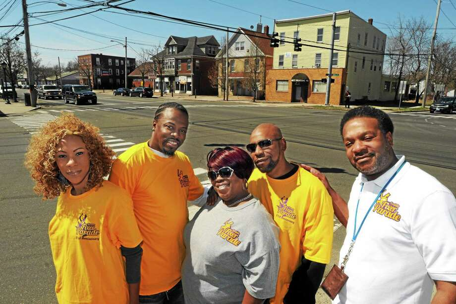 Members of the Freddie Fixer Parade committee on the corner of Marne Street and Dixwell Avenue. From left: Johanna Davis of New Haven, Marion Samuel Jr. of Hamden, Cheryl Holloway-Lytell and Malcolm Lytell, both of Norwich, and Maurice Smith of New Haven. Photo: MARA LAVITT — NEW HAVEN REGISTER     / Mara Lavitt