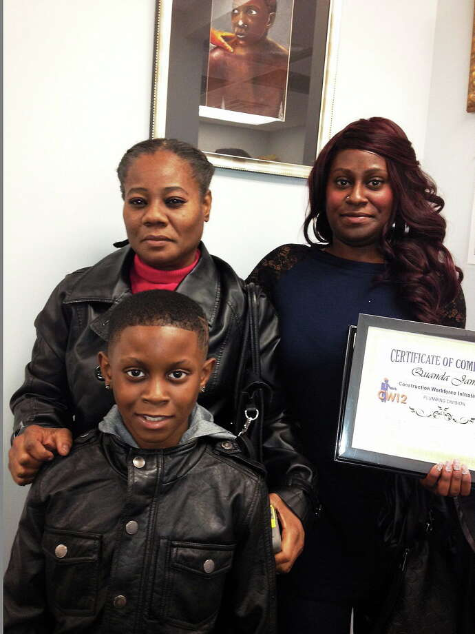 Construction Workshop Initiative grads over two generations: Irmalee Roberts, left, trained as an iron worker and her daughter, Quanda James, is certified in plumbing. So far, Jabarie James, 9, wants to play basketball. Photo: Journal Register Co.