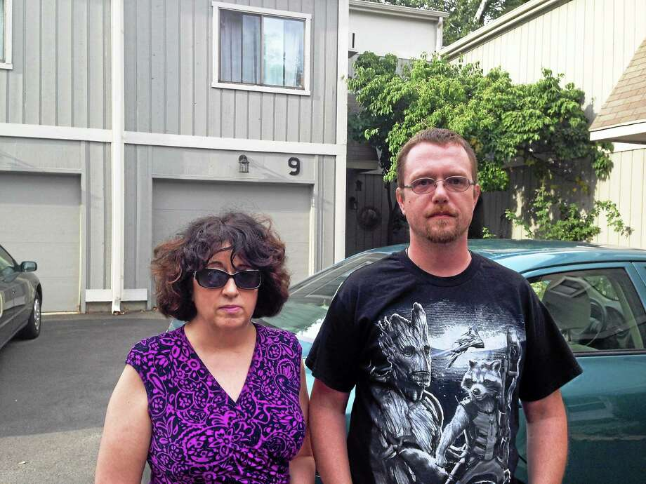Karen East, left, and Keith Roby are concerned about fleas and possibly endangered pets in their condominium complex, West River Village in Guilford. Photo: ED STANNARD — NEW HAVEN REGISTER