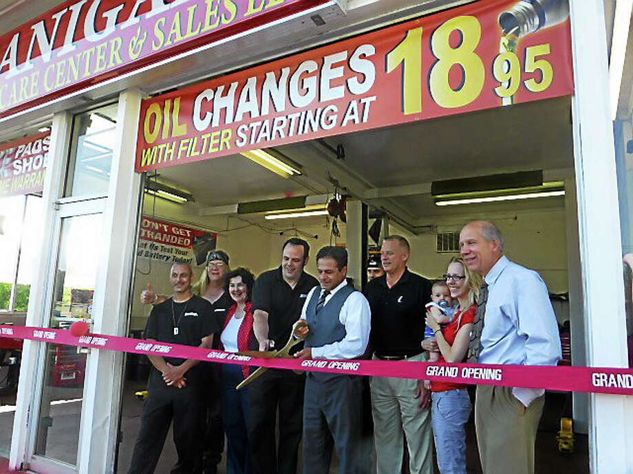 Ansonia officials and owners celebrate the recent opening of Branigan's Car Care Center & Sales. Photo: NEW HAVEN REGISTER