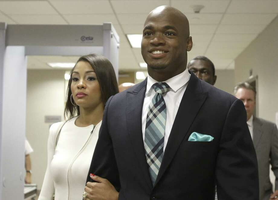 Minnesota Vikings running back Adrian Peterson leaves the courthouse with his wife, Ashley Brown Peterson, on Tuesday in Conroe, Texas. Photo: Pat Sullivan — The Associated Press   / AP