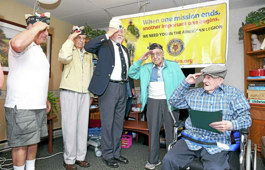 From left, Rich DiSantis, Hamden American Legion Post 150 adjutant; Louis Matteo of Post 150; Bob Murray, past state commander of the Connecticut American Legion; and Fred Baselice of Post 150 salute World War II Army veteran Pasquale Borelli, 104, at the Skyview Center in Wallingford. The nursing home property was recently sold for over $1.7 million.  Photo: Arnold Gold — New Haven Register