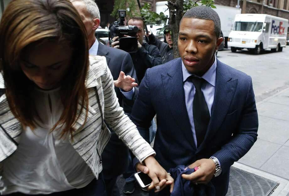 Ray Rice arrives with his wife, Janay Palmer, for an appeal hearing of his indefinite suspension from the NFL on Wednesday in New York. Photo: Jason DeCrow — The Associated Press   / FR103966 AP