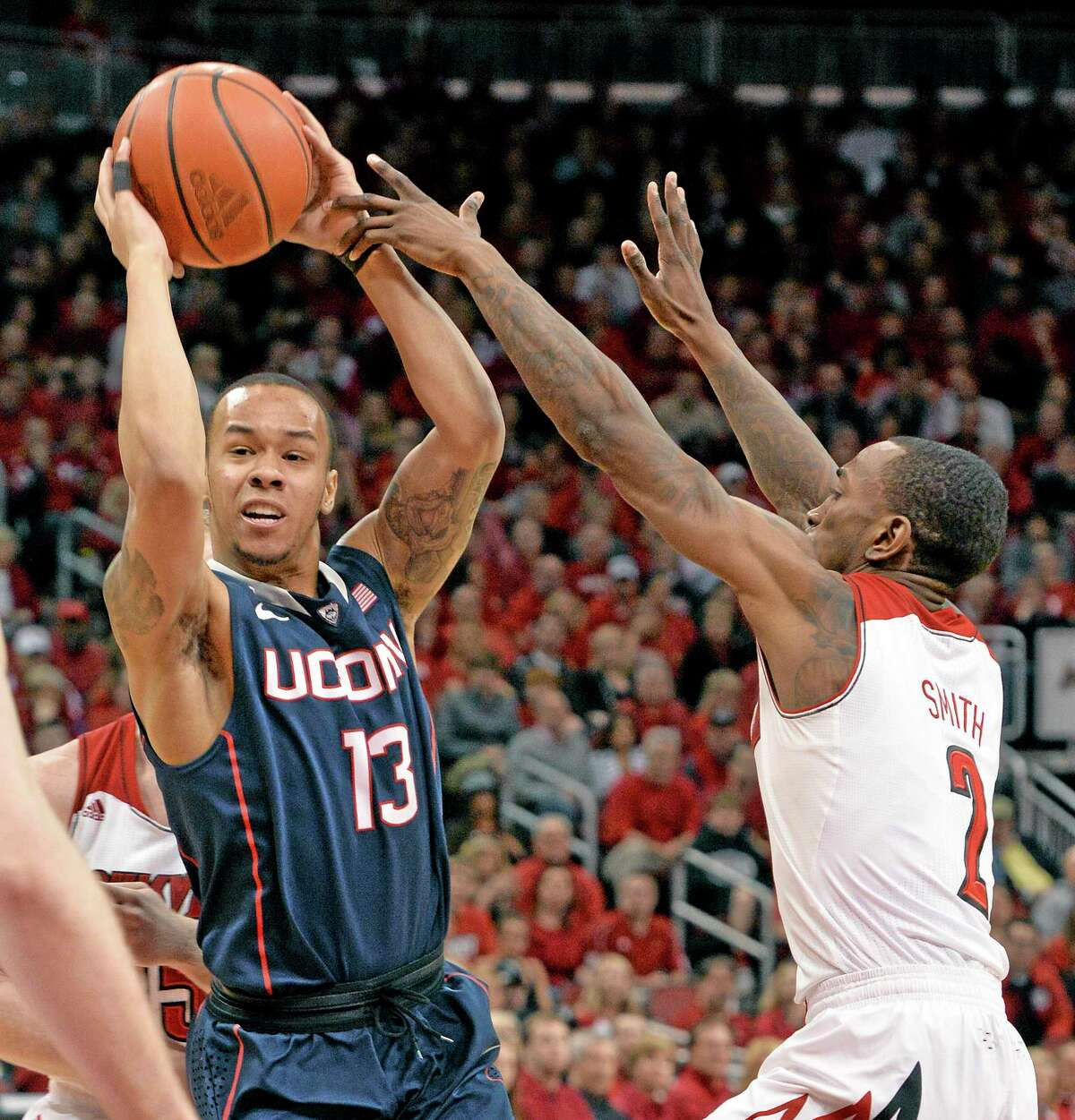 Shabazz Napier, left, edged Louisville's Russ Smith, right, and Cincinnati's Sean Kilpatrick for the inaugural American Athletic Conference Player of the Year award.