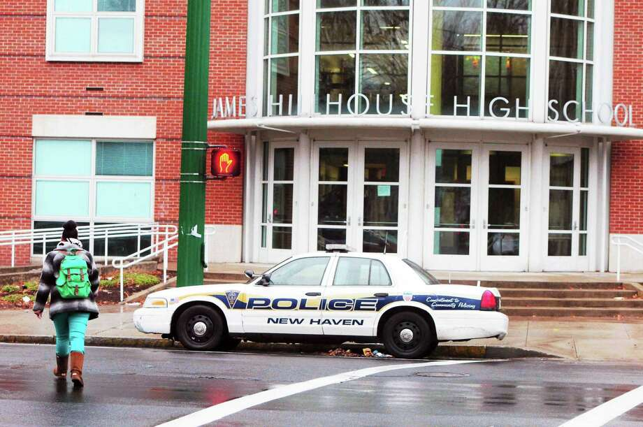 A New Haven police cruiser parked in front of James Hillhouse High School in New Haven Tuesday morning. Photo: Peter Hvizdak — New Haven Register    / ©Peter Hvizdak /  New Haven Register