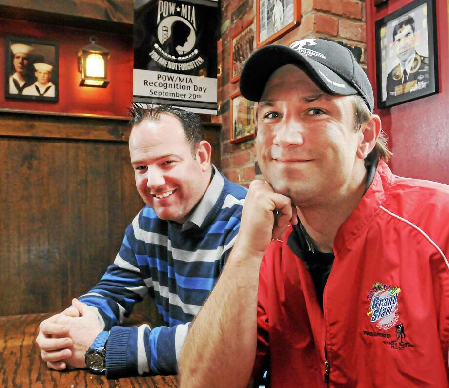 Damian Cashman, co-owner of O'Toole's Irish Pub in New Haven, left, and New Haven Firefighter Douglas McBrierty, an Army veteran of Iraq, at the pub. Photo: Peter Hvizdak — New Haven Register       / ©Peter Hvizdak /  New Haven Register