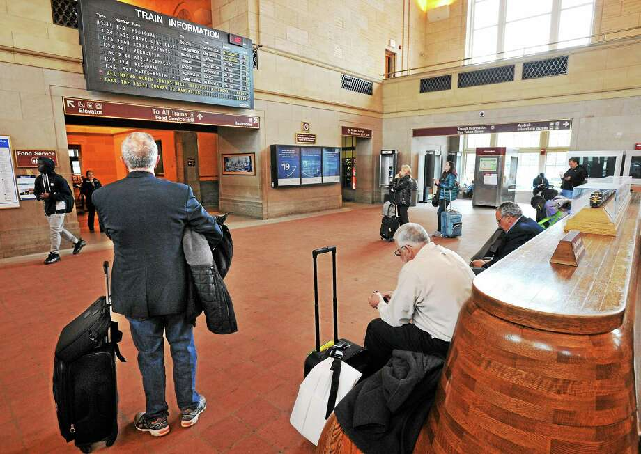 Union Station in New Haven. The status board advises that all trains from New Haven are on time to NY, but the Metro North trains stop in the Bronx and riders will need to take the subway downtown. Photo: Mara Lavitt — New Haven Register   / Mara Lavitt