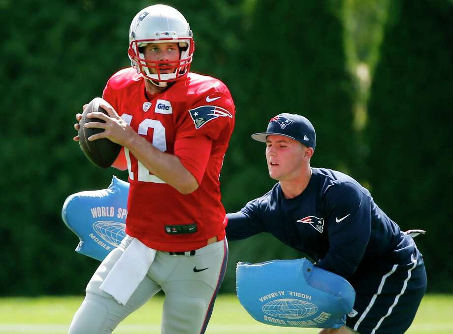 Quarterback Tom Brady and the New England Patriots open the season today against the Dolphins. Photo: AP FILE PHOTO   / AP