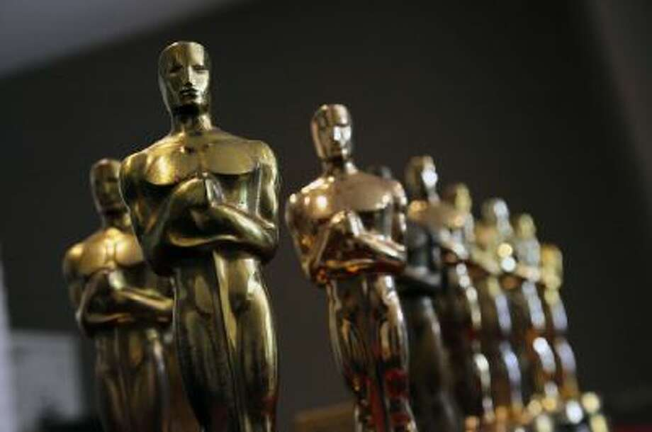 A collection of Oscar statuettes.