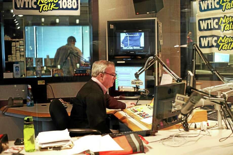 In this undated photo, former Gov. John G. Rowland works in the WTIC studio Photo: Christine Stuart — CTNewsJunkie.com FILE PHOTO