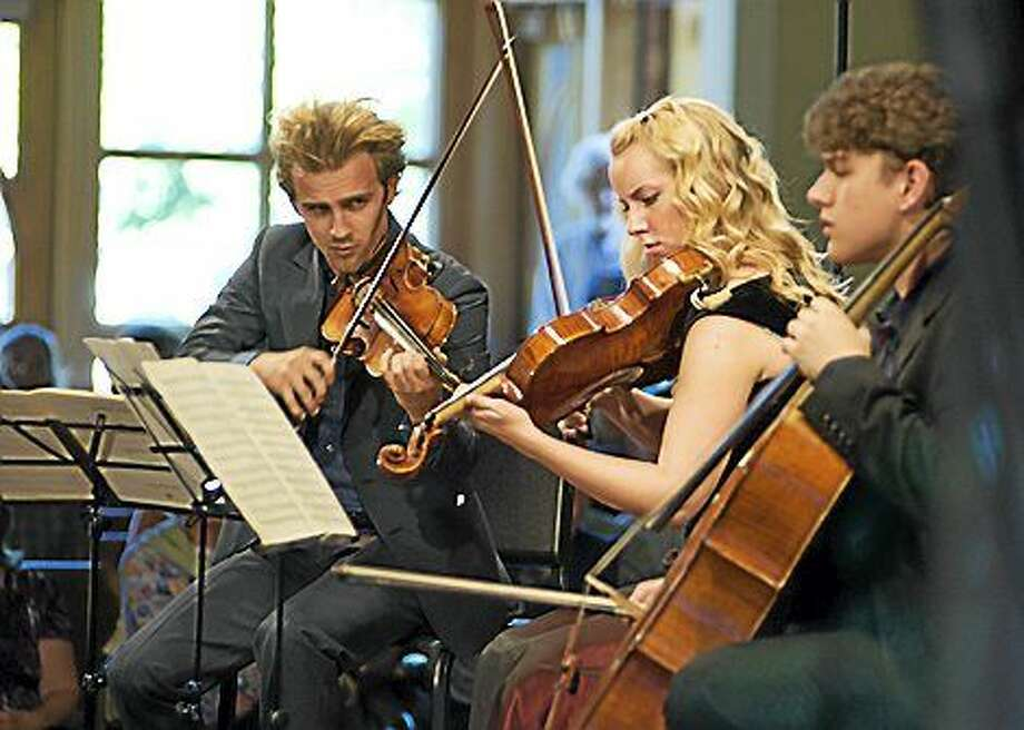 Molly Carr, viola, came up with Project: Music Heals Us while recuperating from her own injury. She's performing here with Timothy Braun, violin; and Gabriel Cabezas, cello. Carr is also on the faculty at Juilliard. Photo: Contributed