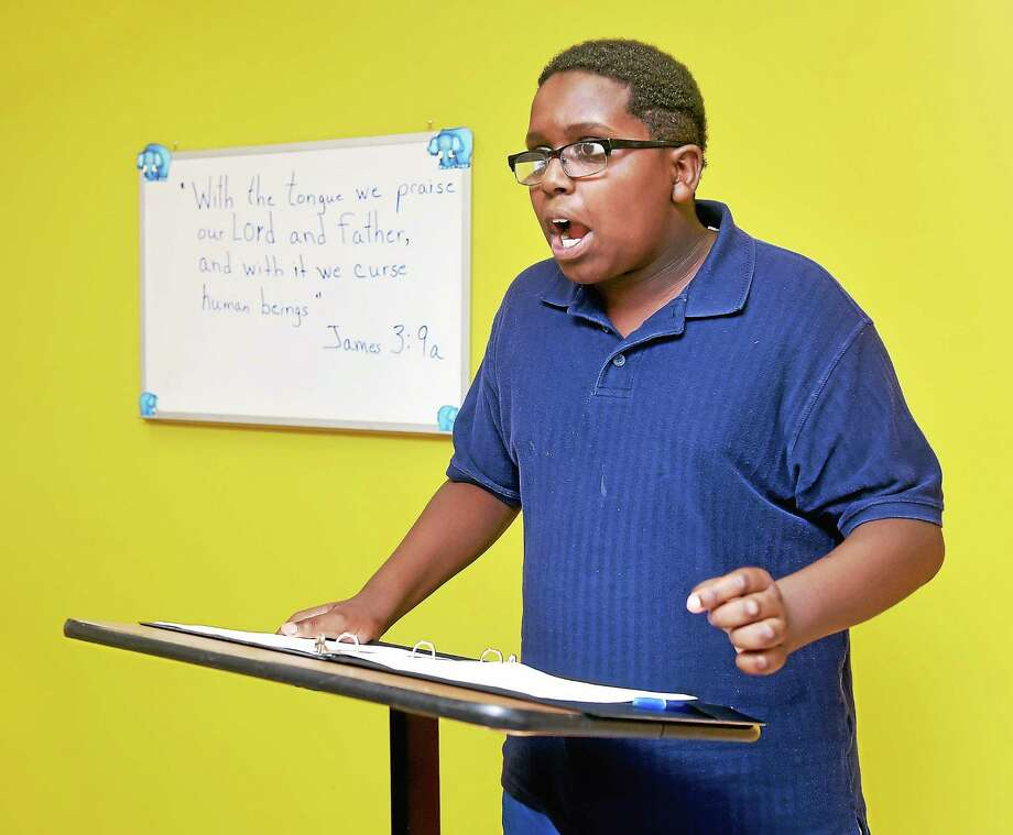 Matthew Brooks, 11, of Boys 2 Men practices for the sixth annual Great Debate sponsored by the Greater New Haven Hope Alliance at the Church on the Rock. Photo: Arnold Gold — New Haven Register