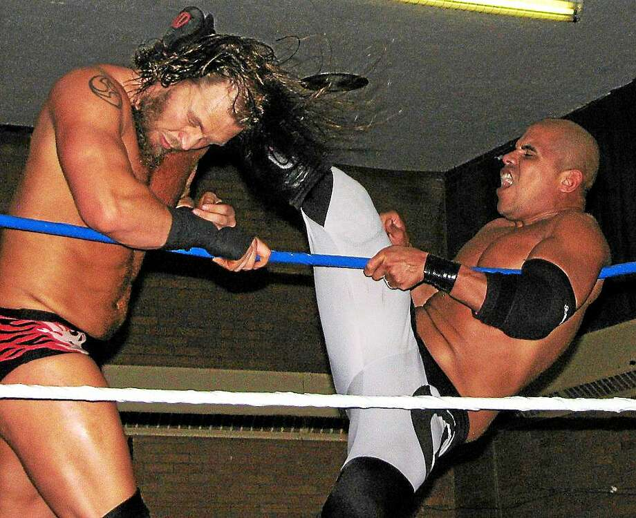 Brian Fury (on left) and Ricky Reyes are the featured wrestlers in the upcoming Paragon League tournament in Hamden. Photo courtesy of John Gjoni. Photo: Journal Register Co.