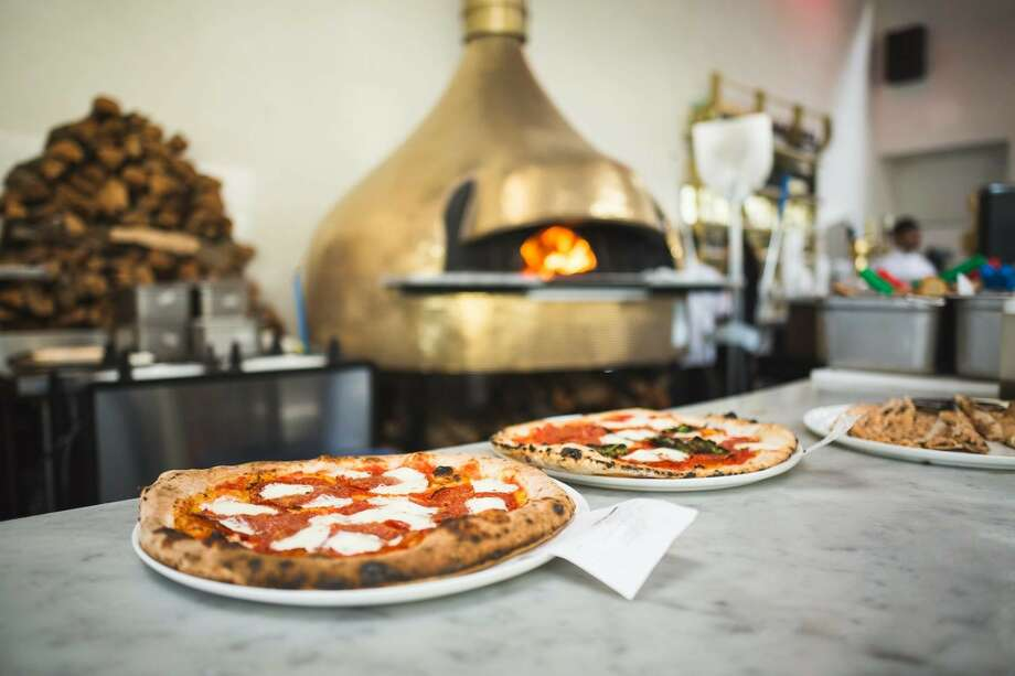 MidiCi Neapolitan Pizza Co. is expanding in the Houston market.Click through the photo gallery for other fast-cook pizza joints. Photo: MidiCi The Neapolitan Pizza Company