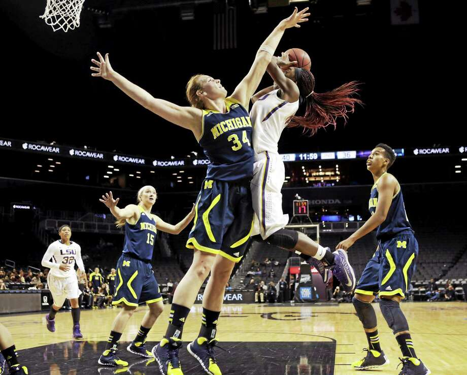 Val Driscoll (34) graduated from Michigan and will use her one remaining year of eligibility to play for Quinnipiac this season. Photo: Kathy Willens — The Associated Press File Photo   / AP