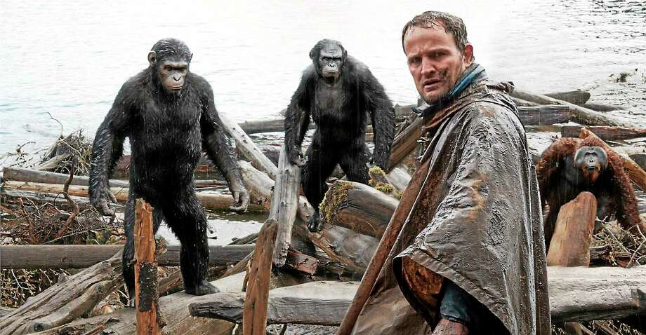 """Dawn of the Planet of the Apes""; with Jason Clarke, as Malcolm, foreground, and, background from left, Andy Serkis, as Caesar; Toby Kebbell, as Koba; and Karin Konoval, as Maurice; earned high marks from this reviewer. Photo: Twentieth Century Fox Film Corporation — THE ASSOCIATED PRESS   / AP2014"