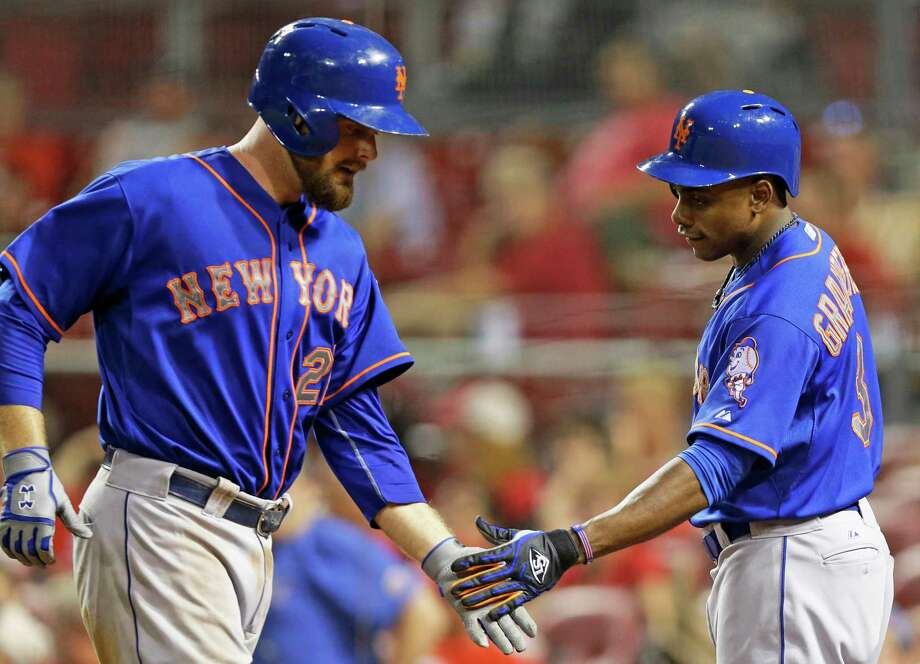 The Mets' Lucas Duda (21) is congratulated by Curtis Granderson (3) after Duda hit a two-run home run off Reds reliever Daniel Corcino in the ninth inning of Friday's game in Cincinnati. Photo: Al Behrman — The Associated Press   / AP