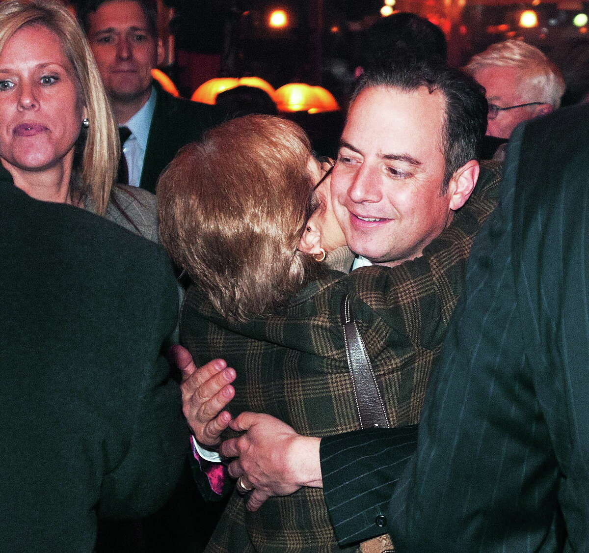 Peter Casolino — New Haven Register National Republican Party Chairman Reince Priebus gets a hug from CT RNC Committeewoman Patricia Longo at Thursday's fundraiser inside the Owl Shop.