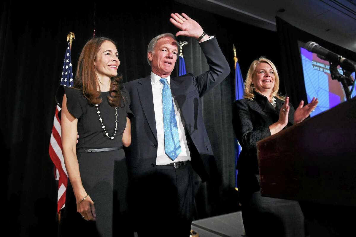 Leslie Fahrenkopf Foley (left) appears with her husband, Tom Foley, as he delivers a qualified concession in the governor's race at the Hyatt Regency in Old Greenwich on 11/4/2014. At right is Lt. Governor candidate Heather Somers.