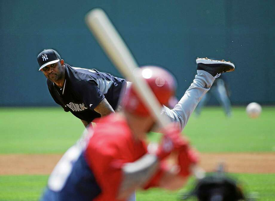 New York Yankees starter CC Sabathia throws to the Washington Nationals' Jeff Kobernus during a spring training game on Tuesday in Viera, Fla. Photo: David Goldman — The Associated Press   / AP