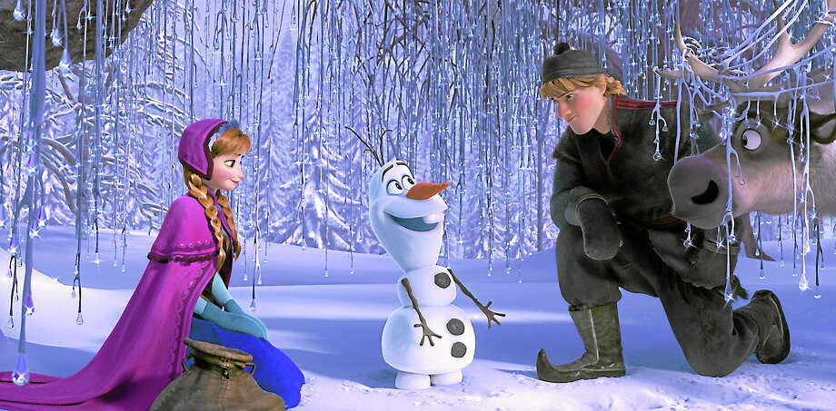 """From left, Anna, voiced by Kristen Bell, Olaf, voiced by Josh Gad, and Kristoff, voiced by Jonathan Groff in a scene from """"Frozen."""" (AP photo) Photo: AP / Disney"""