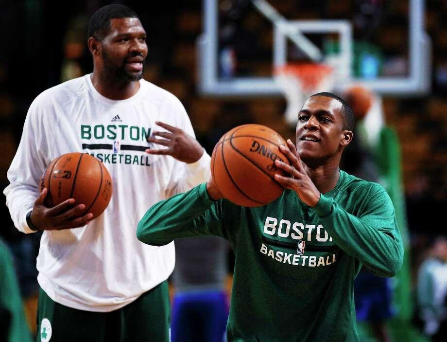 Boston guard Rajon Rondo, right, is expected to return to the Celtics' lineup on Friday. Photo: Elise Amendola — The Associated Press   / AP2013