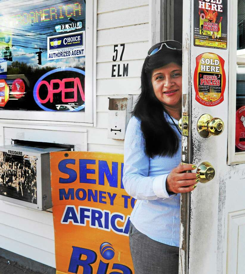 Rita Quezada at Agencia P&B Express, the money wire service business that she runs in West Haven. She says the immigrants she serves send less money to their home countries, which Quezada claims is a strong indicator of weakening job prospects for immigrants. Photo: (Melanie Stengel — New Haven Register)