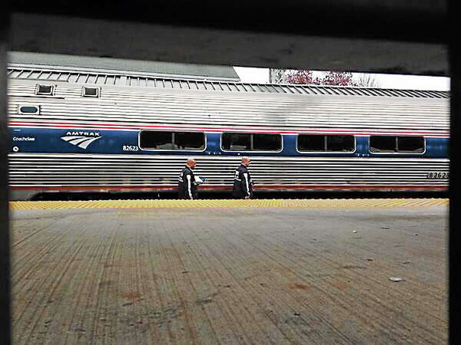 Police investigate after a person was fatally struck by an Amtrak train Friday. Photo: Mercy Quaye — New Haven Register
