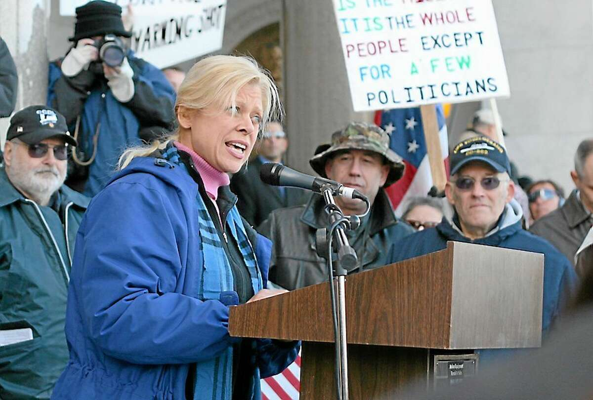 In a file photo, Martha Dean addresses the crowd at a gun rights rally in Hartford.
