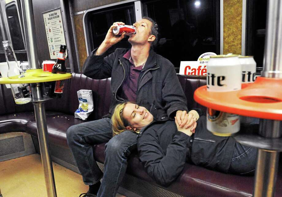Eric and Diana Hass of New York City rode to New Haven for nostalgia on the last ride of Metro-North's bar car. Photo: Mara Lavitt — New Haven Register   / Mara Lavitt