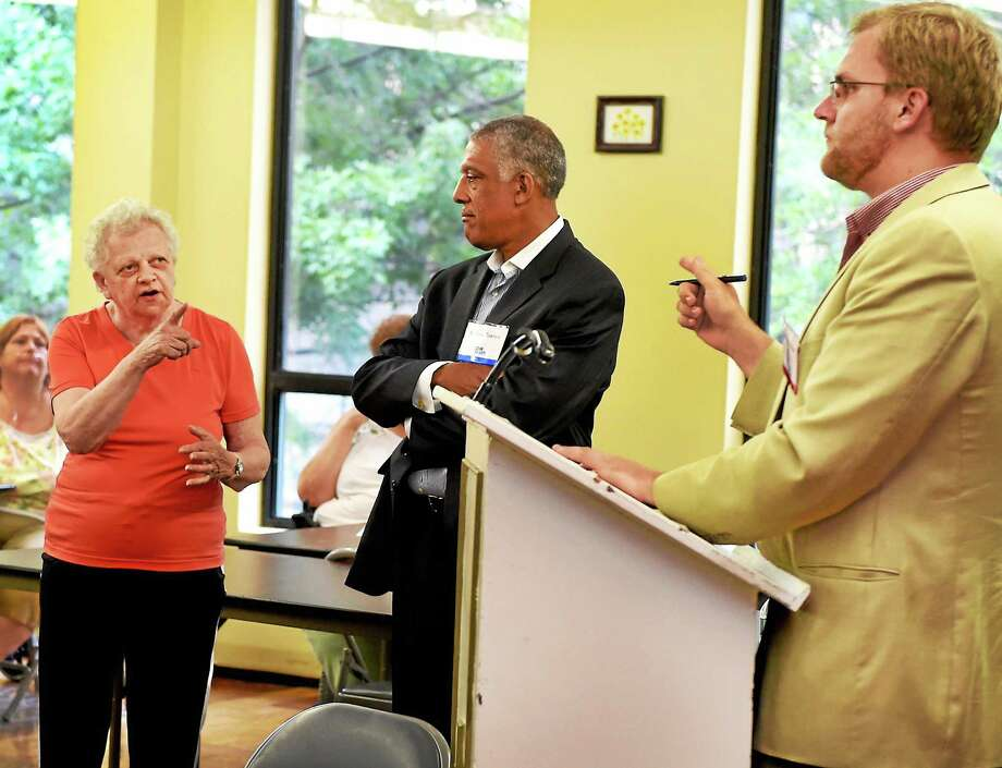 New Haven Ward 11 Alderwoman Barbara Constantinople, a Bella Vista resident, left, makes a point on bus transportation during a discussion with Doug Hausladen, director of the New Haven Department of Transportation, Traffic and Parking, right, and Michael Townes, senior vice president of CDM Smith, center, during a transit study public meeting at Bella Vista Wednesday. Photo: Peter Hvizdak — New Haven Register   / ©Peter Hvizdak /  New Haven Register