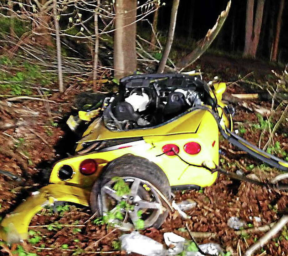 A yellow 2005 Chevrolet Corvette crashed into a wooded area off Sherman Avenue in Hamden Thursday night. The driver was taken to a local hospital. Firefighters had to cut the roof of the car off to free the driver. Photo: Contributed Photo — Hamden Professional Firefighters Local 2687