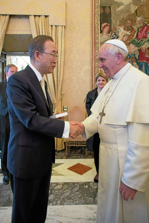 "In this photo provided by the Vatican newspaper L'Osservatore Romano, Pope Francis greets U.N. Secretary-General Ban Ki-moon at the Vatican, Friday, May 9, 2014. Pope Francis called Friday for governments to redistribute wealth to the poor in a new spirit of generosity to help curb the ""economy of exclusion"" that is taking hold today. Francis made the appeal during a speech to U.N. Secretary-General Ban Ki-moon and the heads of major U.N. agencies who are meeting in Rome this week. Latin America's first pope has frequently lashed out at the injustices of capitalism and the global economic system that excludes so much of humanity. (AP Photo/L'Osservatore Romano) Photo: AP / L' Osservatore Romano"