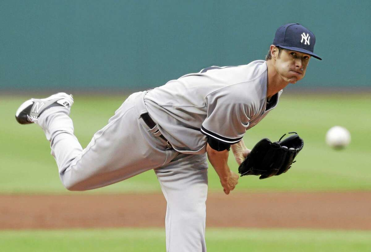 Yankees starting pitcher Shane Greene delivers in the first inning of a game against the Cleveland Indians Monday.