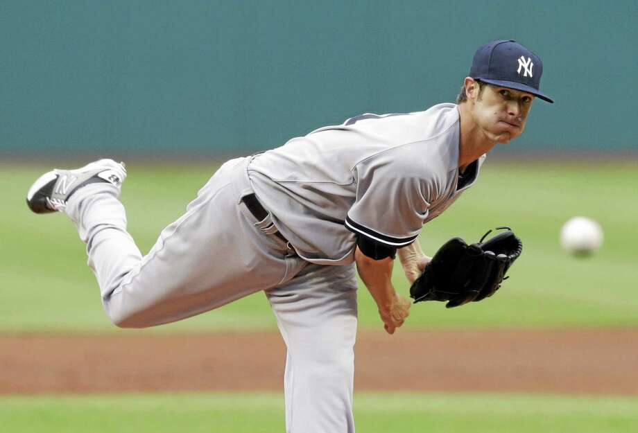Yankees starting pitcher Shane Greene delivers in the first inning of a game against the Cleveland Indians Monday. Photo: Tony Dejak — The Associated Press   / AP