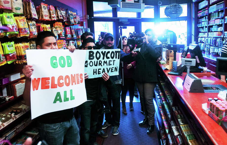 Former employees ask to see the owner of Gourmet Heaven during a protest in support of four workers who were allegedly fired because they went to the state Department of Labor over a pay dispute. Photo: Peter Casolino — New Haven Register