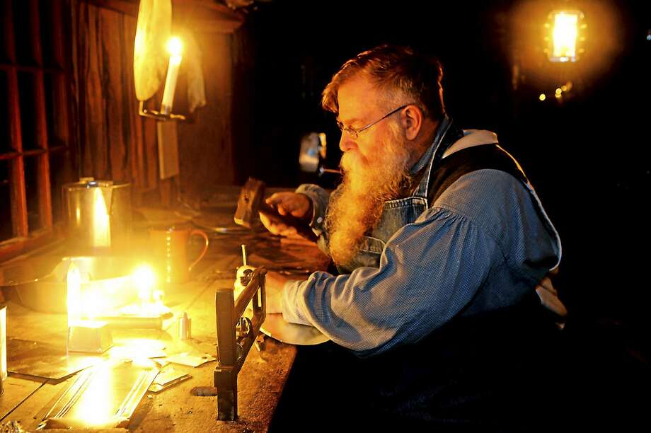 The tin shop glowed during last year's Night of Illumination at Old Sturbridge Village. Photo: OSV
