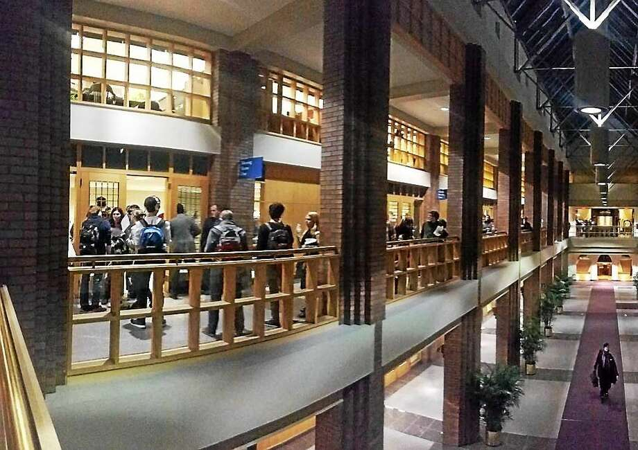 New Haven residents wait in line to register and then vote on Election Day Tuesday at City Hall. Photo: Evan Lips — New Haven Register