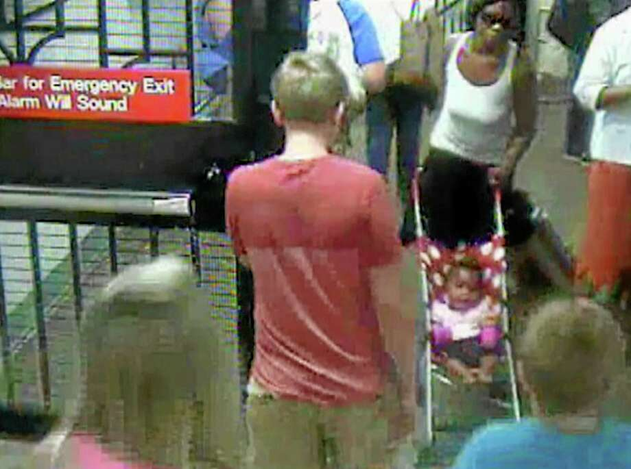 In this Monday, July 7, 2014 surveillance camera image provided by the New York Police Department, a woman, top right, pushes her baby girl in a stroller at the Columbus Circle subway station in New York. The 20-year-old woman, who is suspected of abandoning the baby at the Manhattan station, was in police custody on Tuesday. (AP Photo/NYPD) Photo: AP / AP
