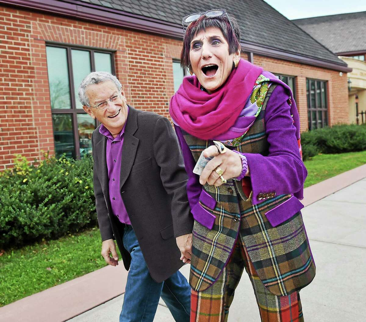 U.S. Rep. Rosa L. DeLauro and her husband, political strategist Stanley Greenberg, arrive at Celentano Biotech, Health and Medical Magnet School on Canner Street in New Haven to vote Tuesday.