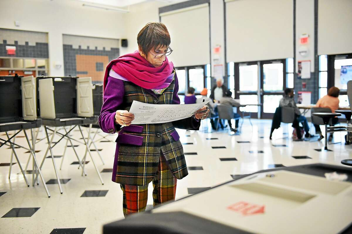 U.S. Rep. Rosa L. DeLauro looks over her election ballot Tuesday.