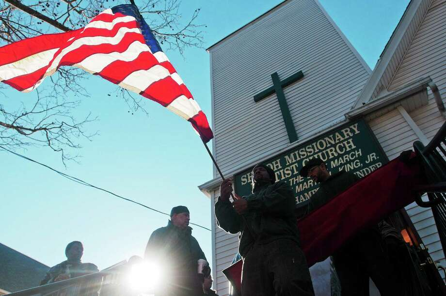 People leave Shiloh Missionary Baptist Church after the 44th Martin Luther King Jr. Love March Wednesday in New Haven. Photo: Peter Casolino — New Haven Register