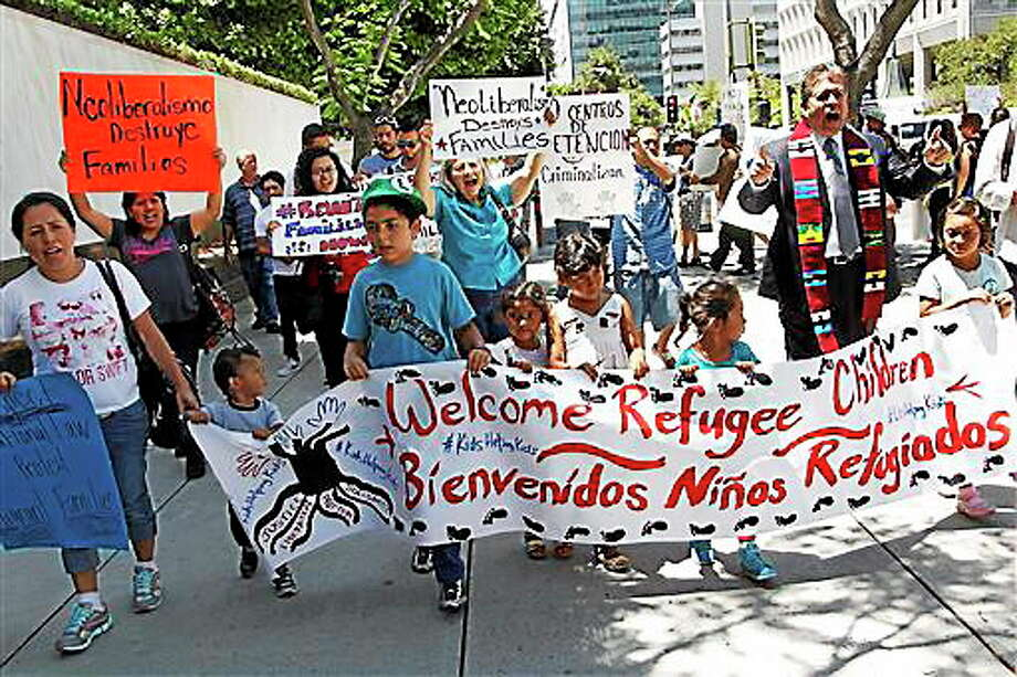 In this July 7, 2014 file photo, immigrant families and children's advocates rally in response to President Barack Obama's statement on the crisis of unaccompanied children and families illegally entering the United States, outside the Los Angeles Federal building. Tackling what he has called a humanitarian crisis, Obama on Tuesday, July 8, 2014 asked Congress for $3.7 billion to cope with a tide of minors from Central America who are illegally crossing the U.S. border, straining immigration resources and causing a political firestorm in Washington. Photo: Associated Press   / AP