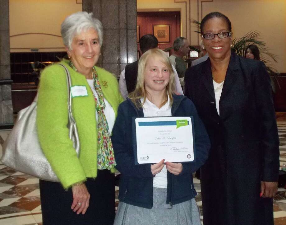 Sister Mary McCarthy (left) and Treasurer Denise Nappier (right) pose with Mercy High student Julia Taylor (middle) as she receives her CHET scholarship. Photo: Journal Register Co.