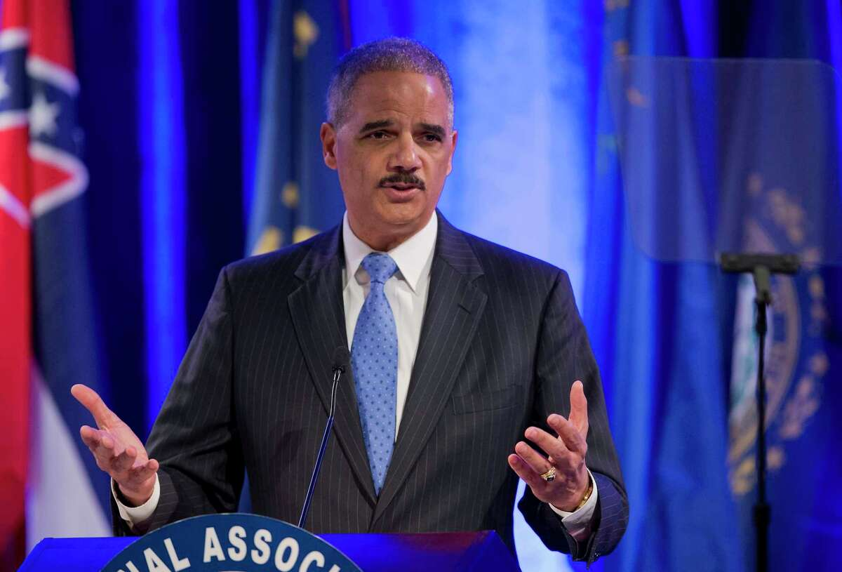 Attorney General Eric Holder speaks at the annual Attorneys General Winter Meeting in Washington, Tuesday, Feb. 25, 2014.