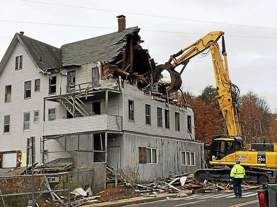 The former historic Seymour Lumber & Supply Co. was demolished Sunday. Photo: (Contributed Photo)