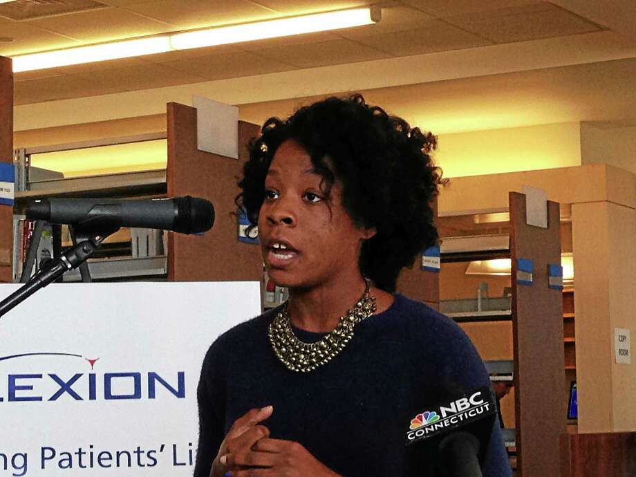 Laurren Robinson, a Gateway Community College student, talks about the importance of subsidized bus passes Monday in New Haven. Photo: Ed Stannard — New Haven Register