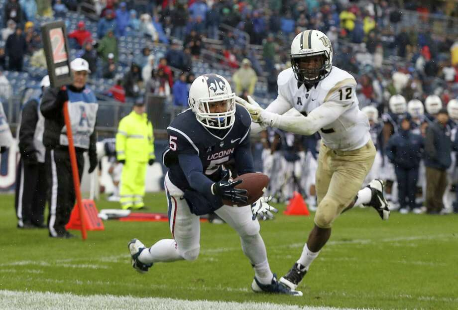 Though he wasn't able to catch this potential touchdown on Saturday, UConn wide receiver Noel Thomas (5) was on the receiving end of two other touchdown passes in Saturday's win over Central Florida. Photo: The Associated Press   / AP