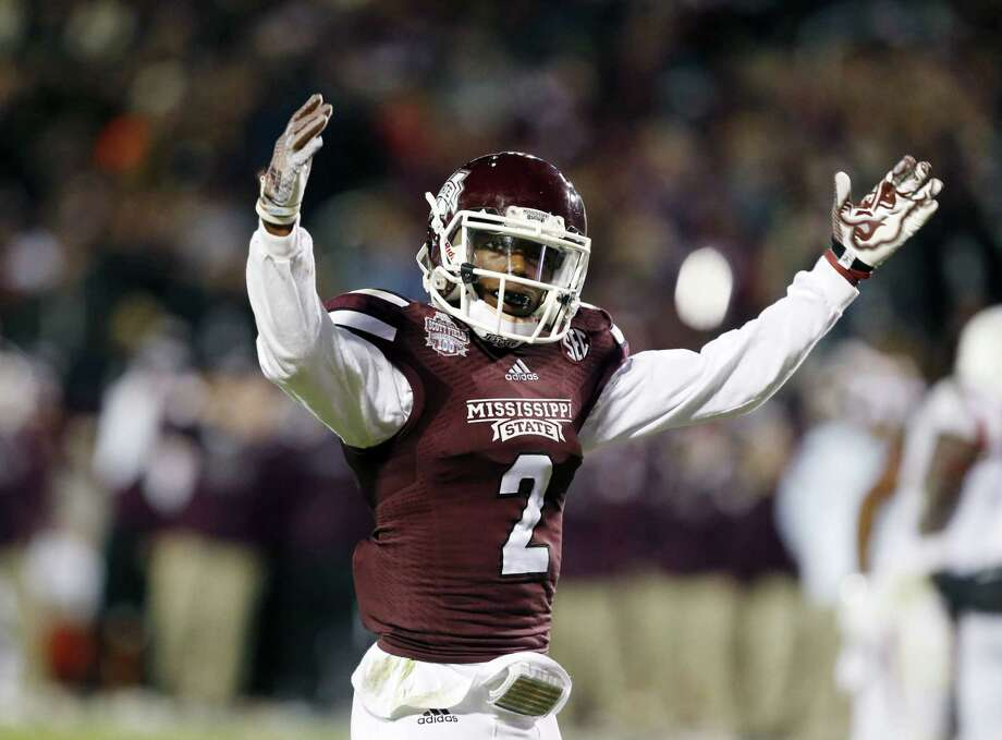 Mississippi State defensive back Will Redmond (2) encourages fan support against Arkansas in the second half Saturday. Photo: Rogelio V. Solis — The Associated Press   / AP
