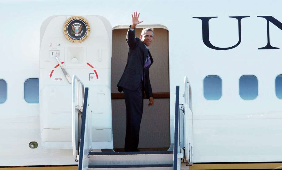 President Barack Obama departs Westchester County Airport in New York, Friday, Aug. 29, 2014, on his way to Newport Rhode Island. (AP Photo/David Karp) Photo: AP / FR50733-AP
